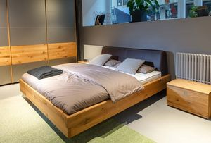 nox solid wood bed in oak with leather headboard at TEAM 7 Hamburg City