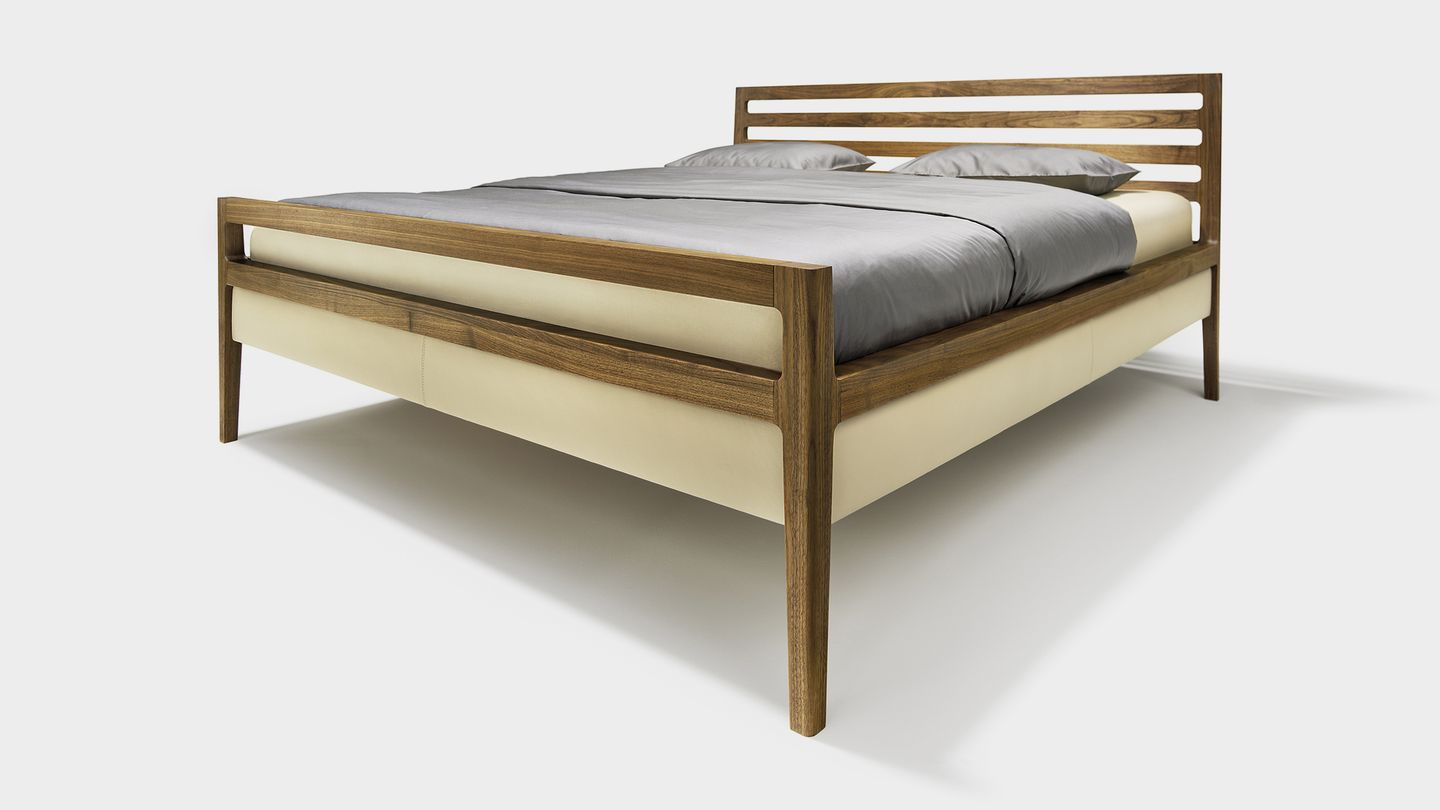 mylon bed in walnut made of solid wood