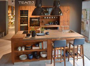 loft solid wood kitchen in walnut at TEAM 7 store Stuttgart