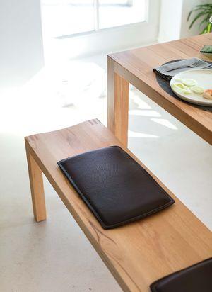 Banquette loft en bois naturel avec revêtement en cuir