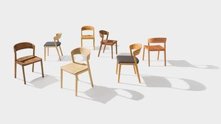 mylon chair in wood, upholstered with leather or fabric for premium seating comfort