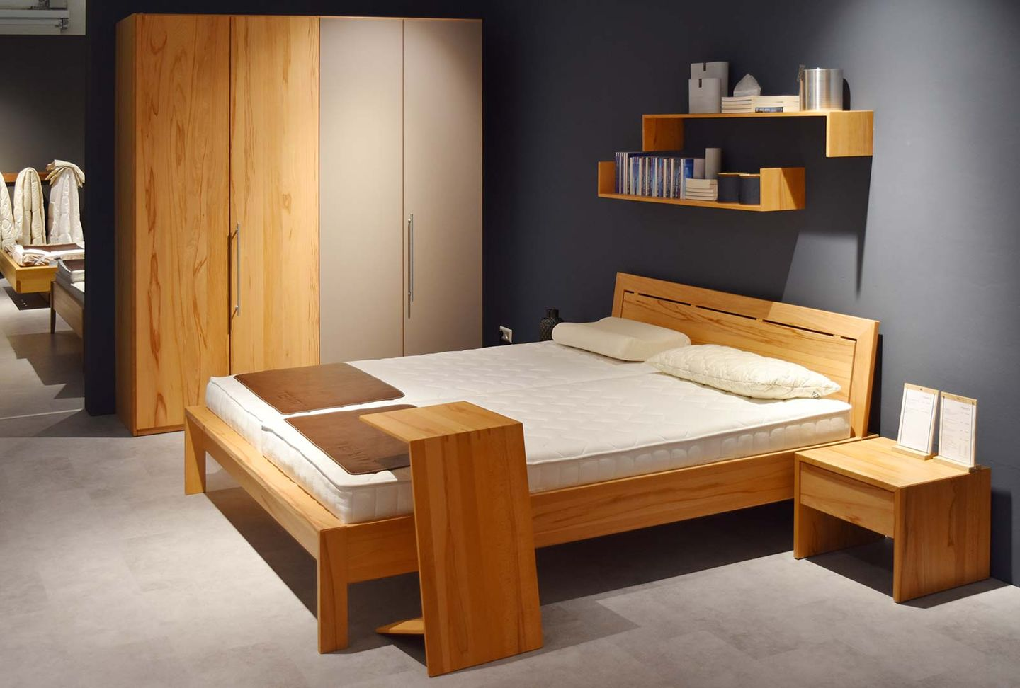 lunetto solid wood bed at TEAM 7 store Stuttgart