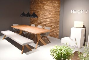 yps dining table with yps cushioned bench at TEAM 7 store Hamburg City
