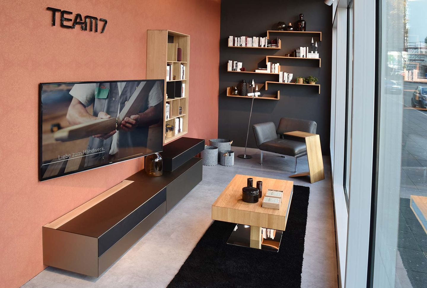 cubus pure wall unit with coloured glass fronts at TEAM 7 Stuttgart