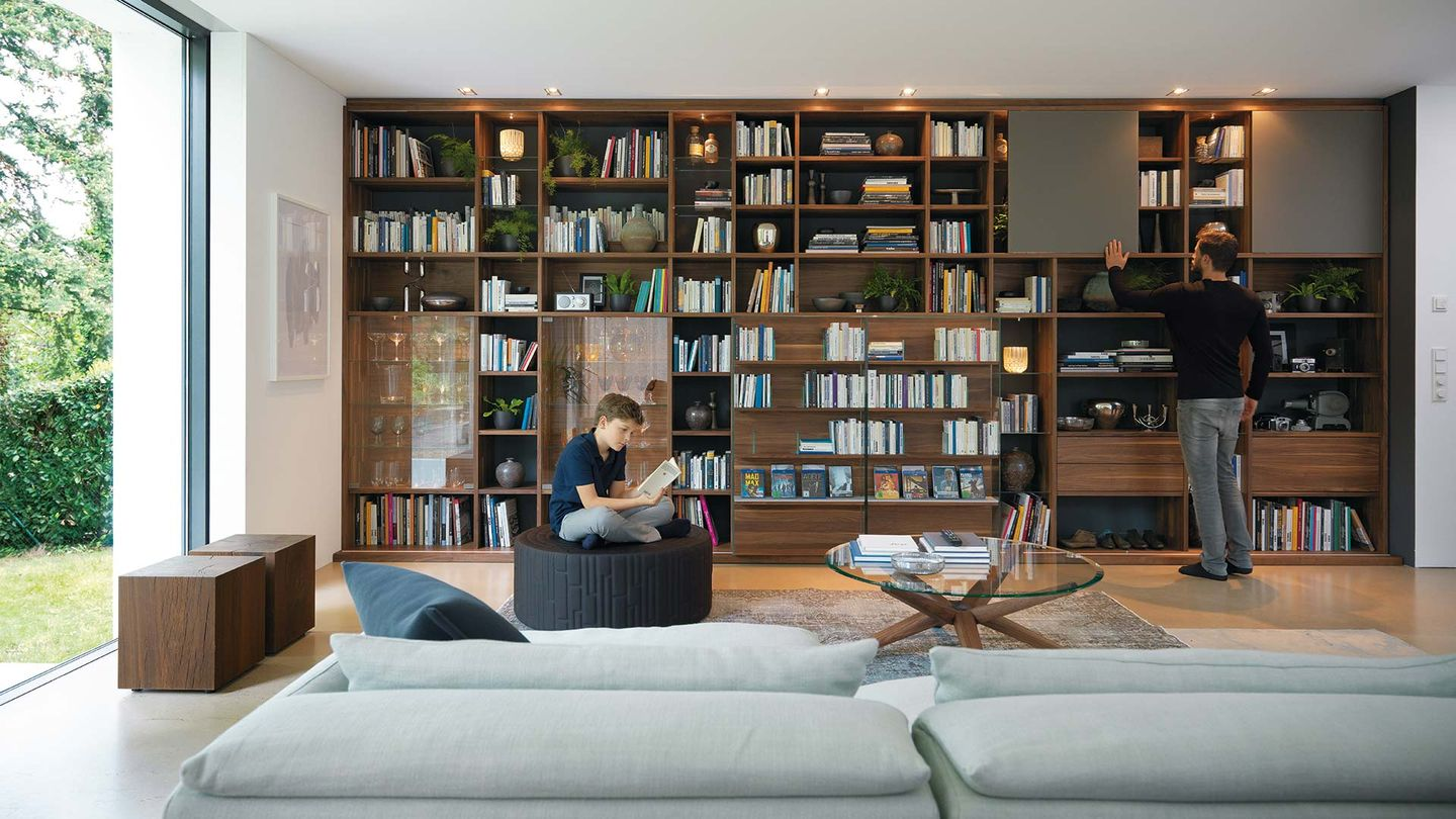 cubus library in walnut integrated into the cubus wall unit
