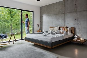riletto bed with leather bed sides made of solid wood