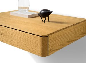 float bedside cabinet made of wood with rounded corners
