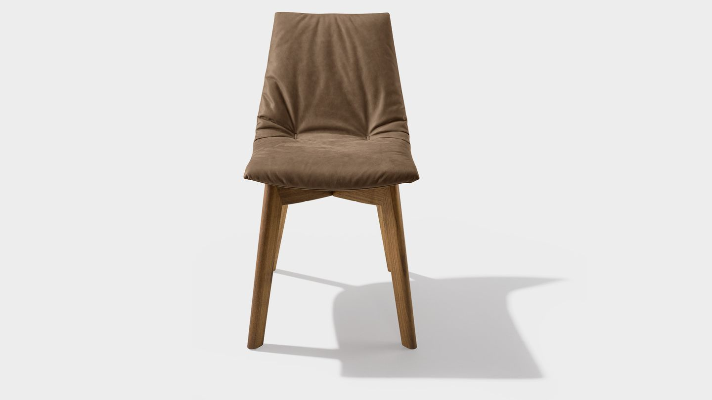 lui chair with leather tarfufo, and wooden legs