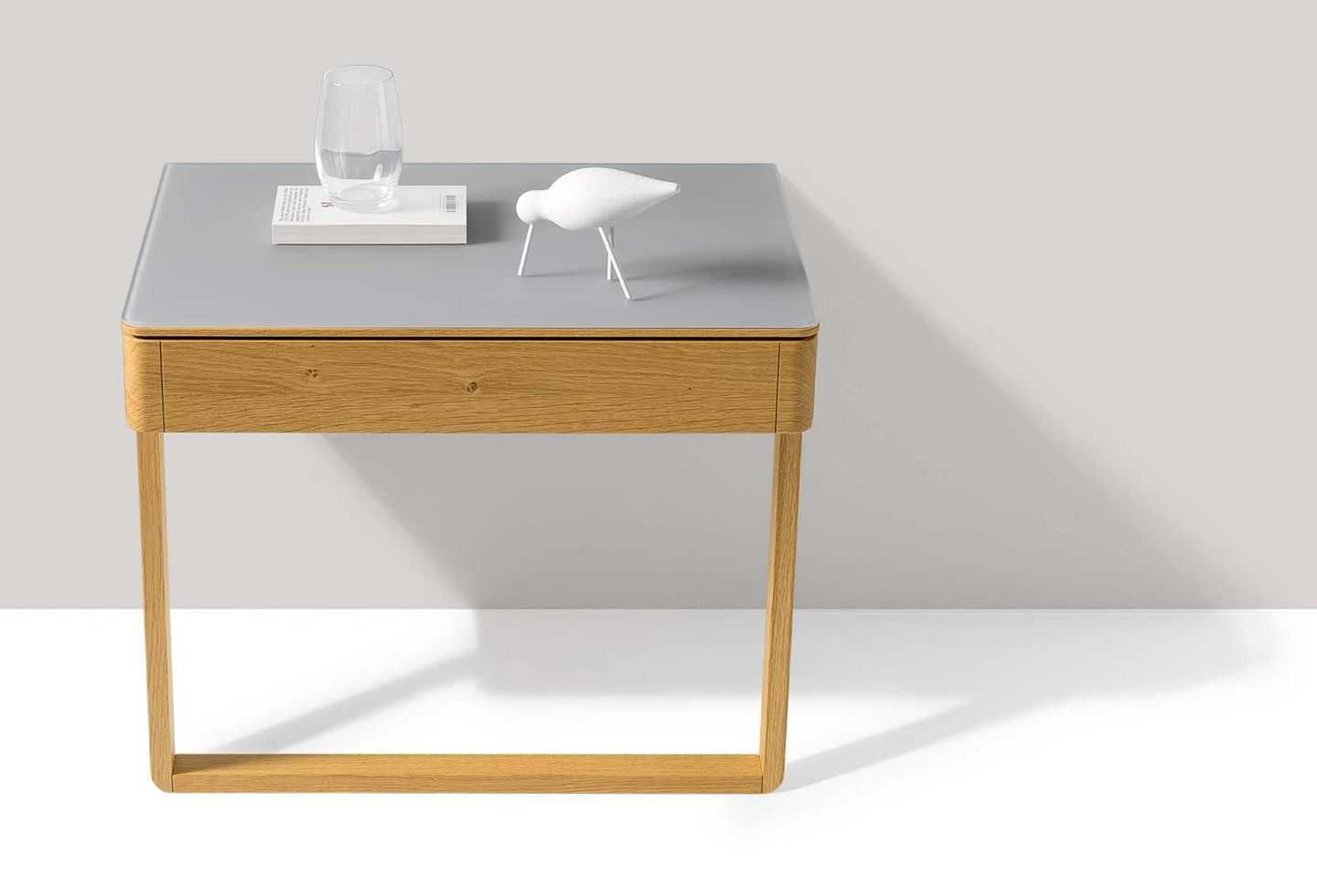 float bedside cabinet made of wood with glass surface and wooden frame