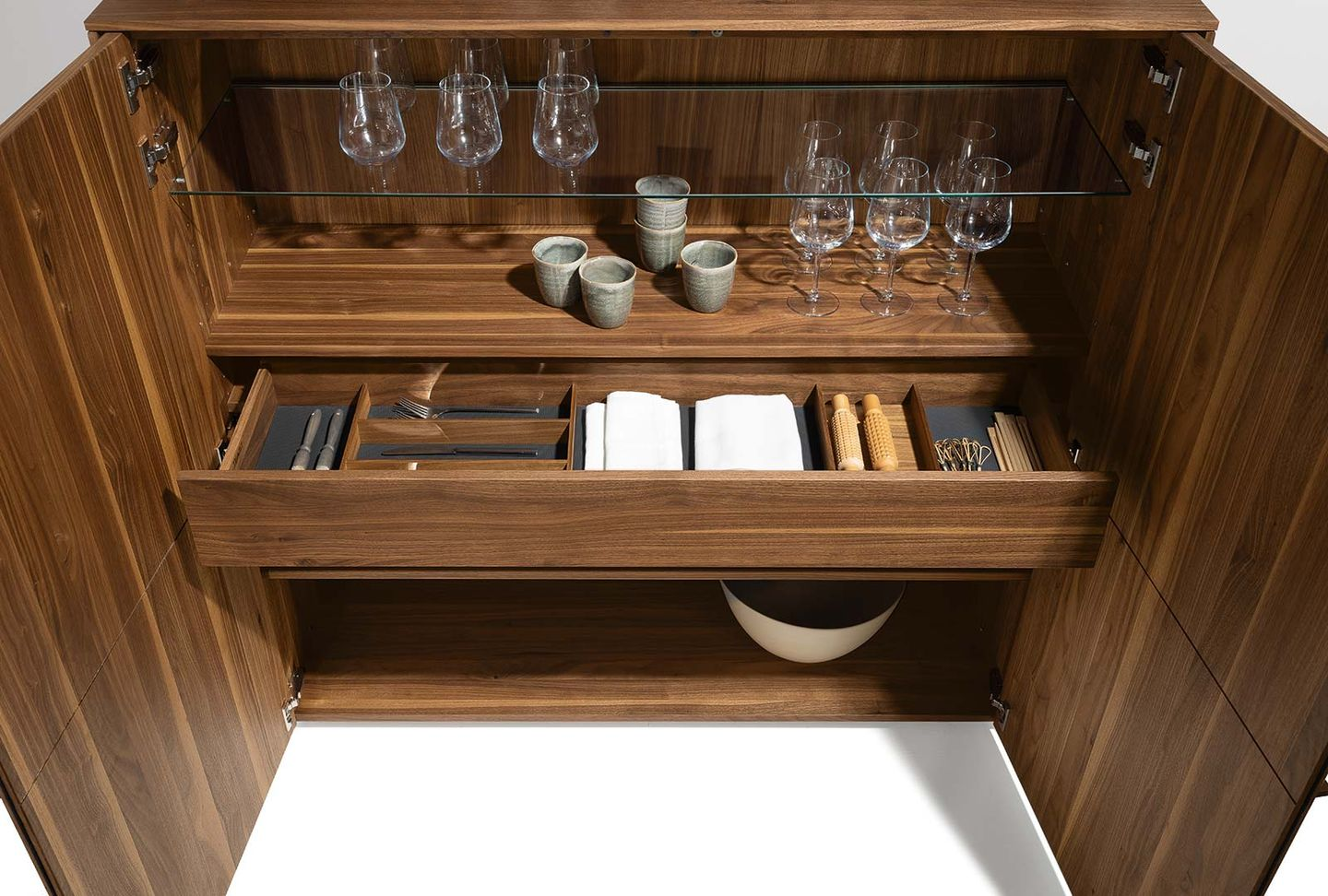 filigno highboard with a practical interior in walnut