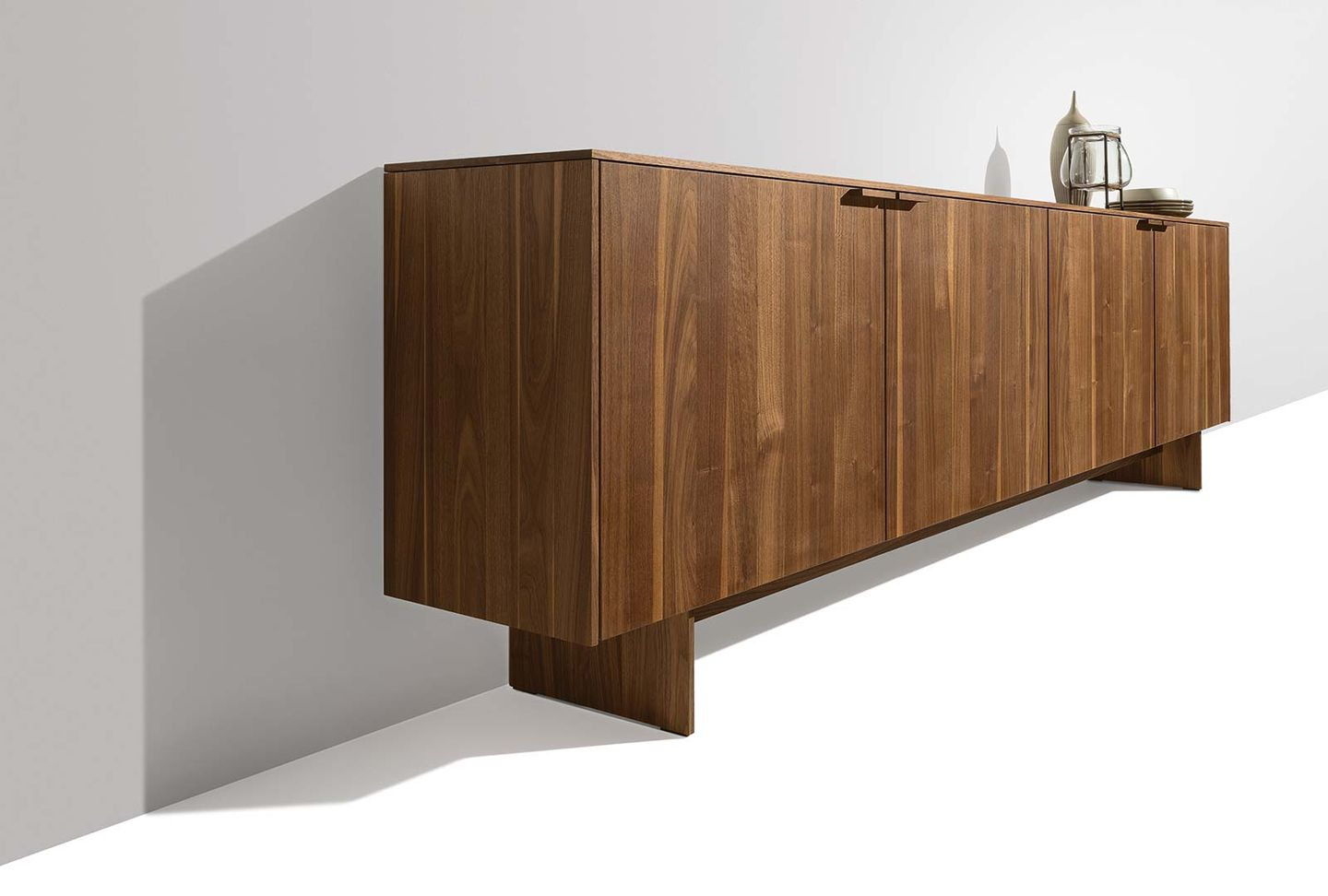 filigno sideboard with wooden panels in walnut from the side