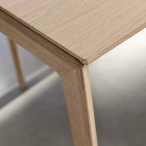 Designer tak extendable table with wooden legs, minimalist material thickness