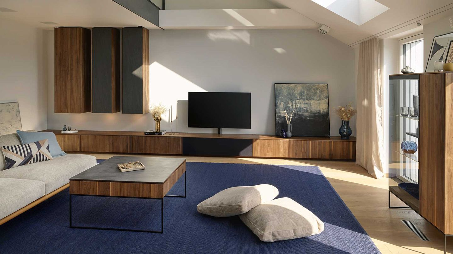 filigno wall unit and coffee table in walnut by TEAM 7