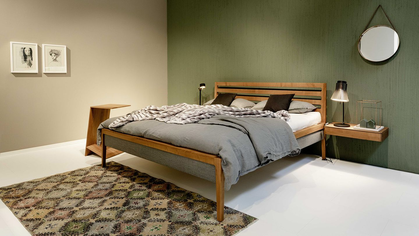 mylon bed with fabric headboard made of solid wood at TEAM 7 Wels