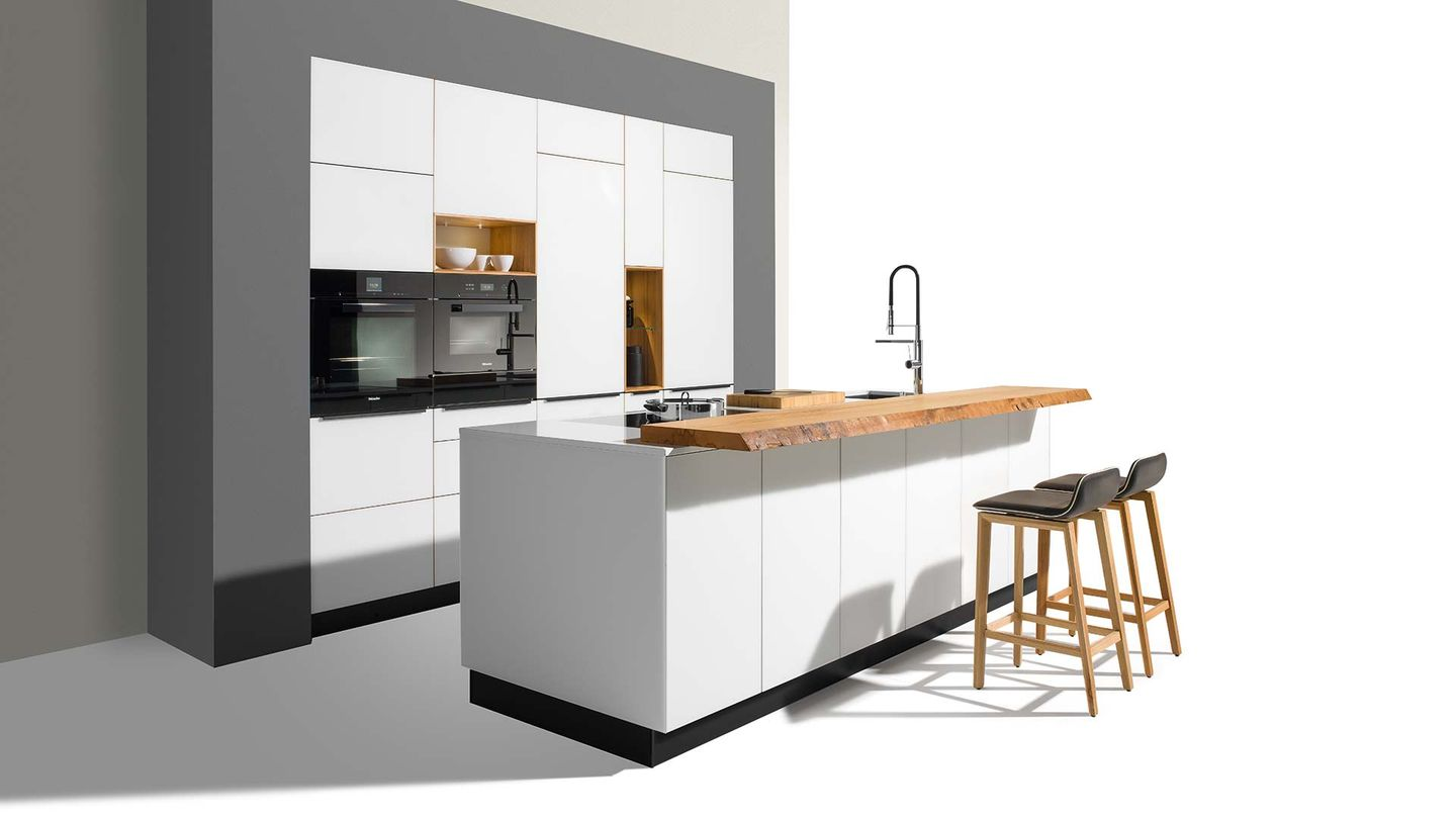 linee designer kitchen with coloured glass fronts in white