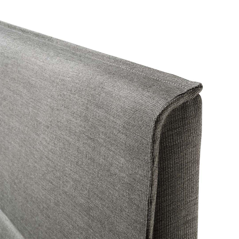 Lit float avec tête de lit en tissu ornée d'une bordure continue