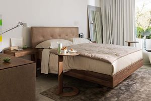 float bed with natural leather headboard in walnut