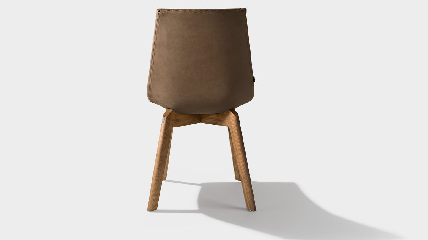 lui chair with walnut legs and tartufo leather