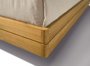 float wood bed with rounded corners