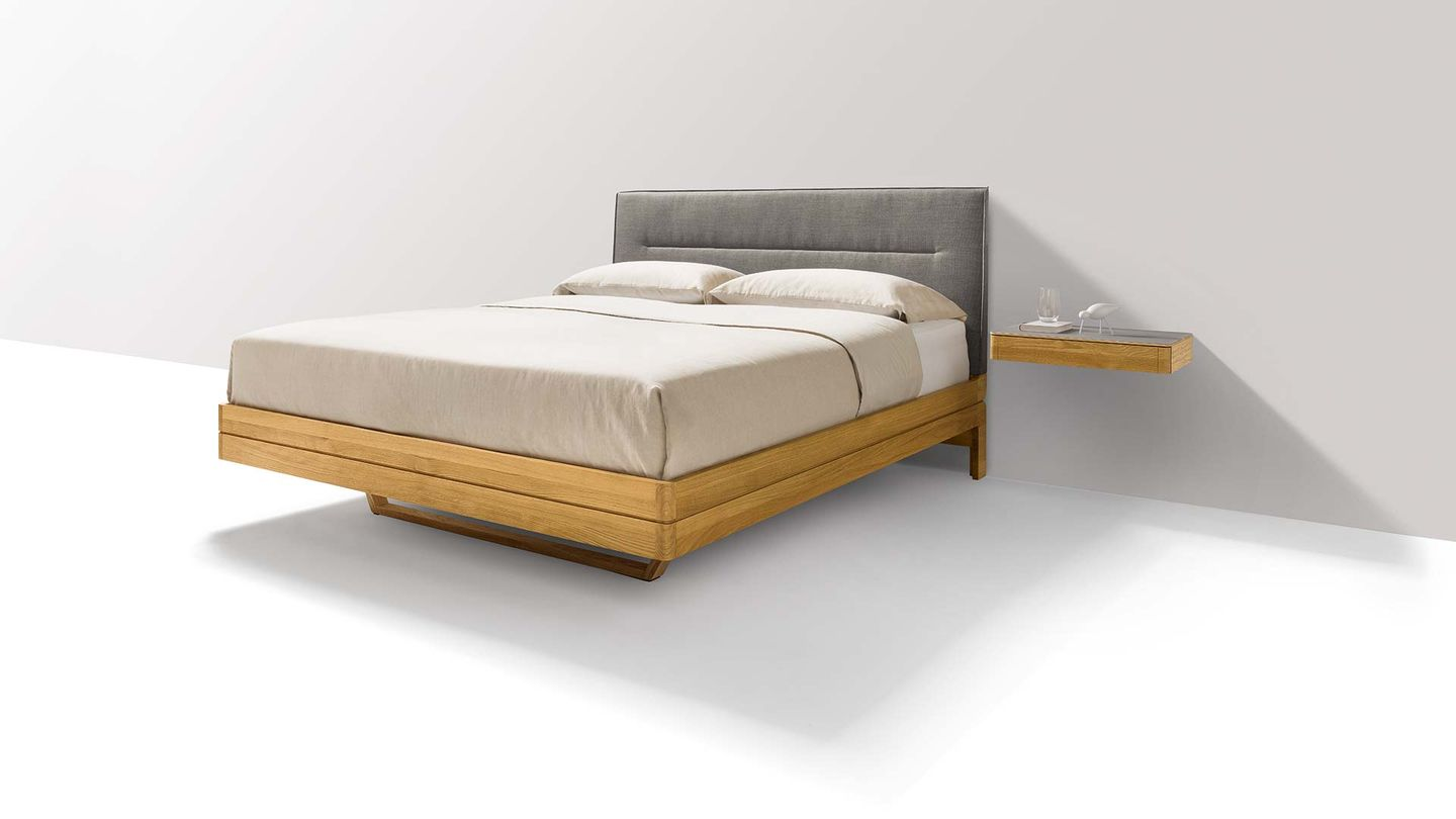 float wood bed in oak with headboard in fabric