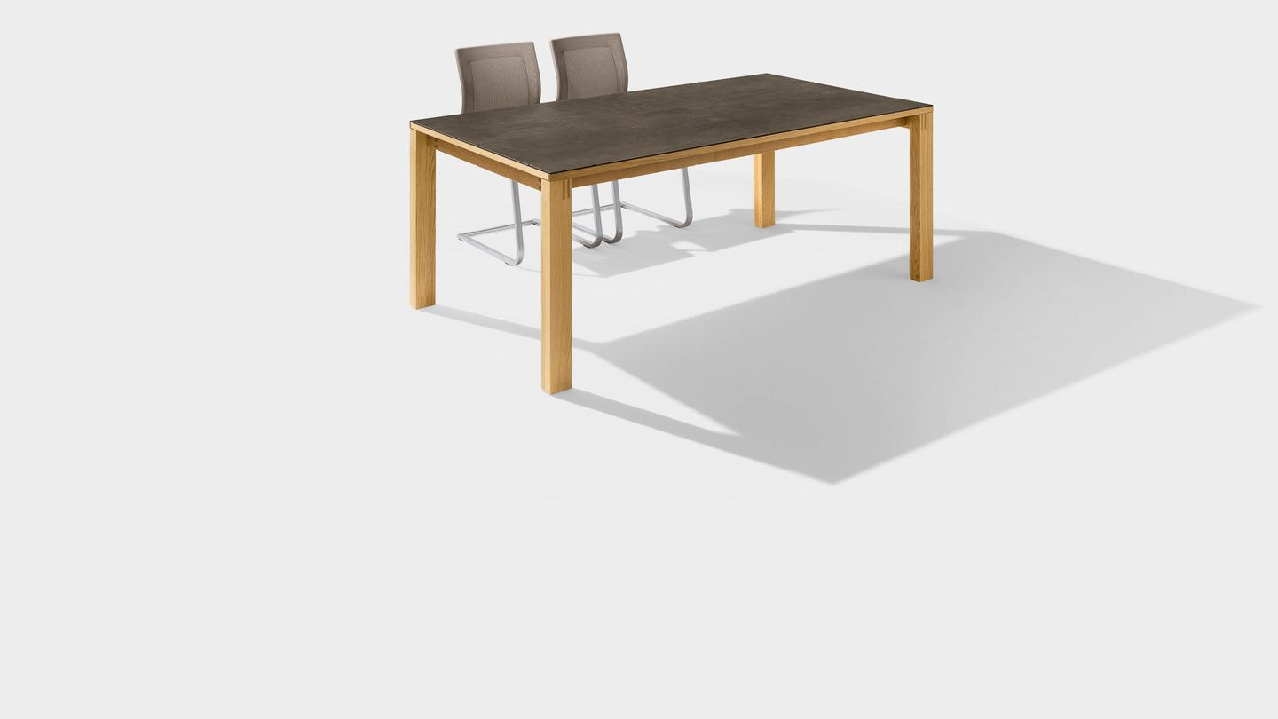 magnum dining table made of wood with ceramic surface