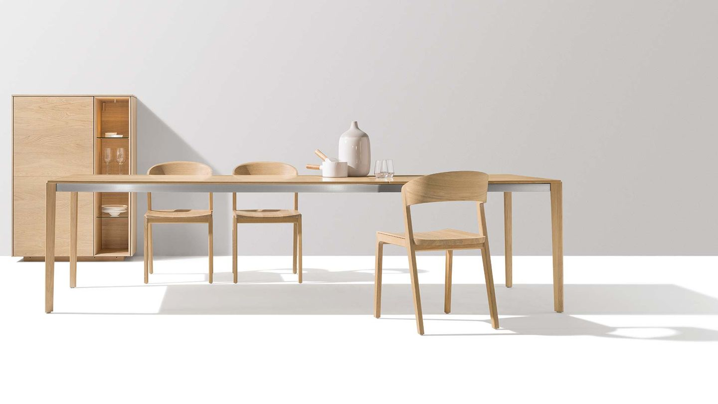 tak extendable table with mylon chair made from solid wood