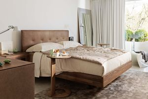 float solid wood bed by TEAM 7 with loup side table