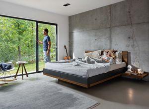 Bett riletto mit Lederbettseiten aus Naturholz