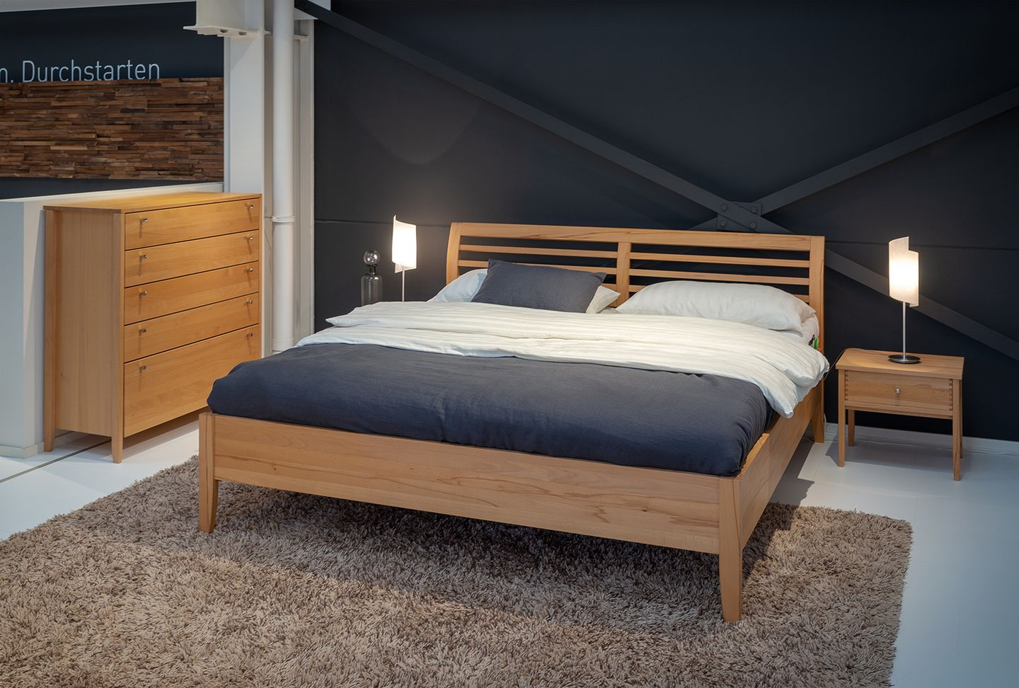 mylon bed with slatted headboard at TEAM 7 store Hamburg Altona