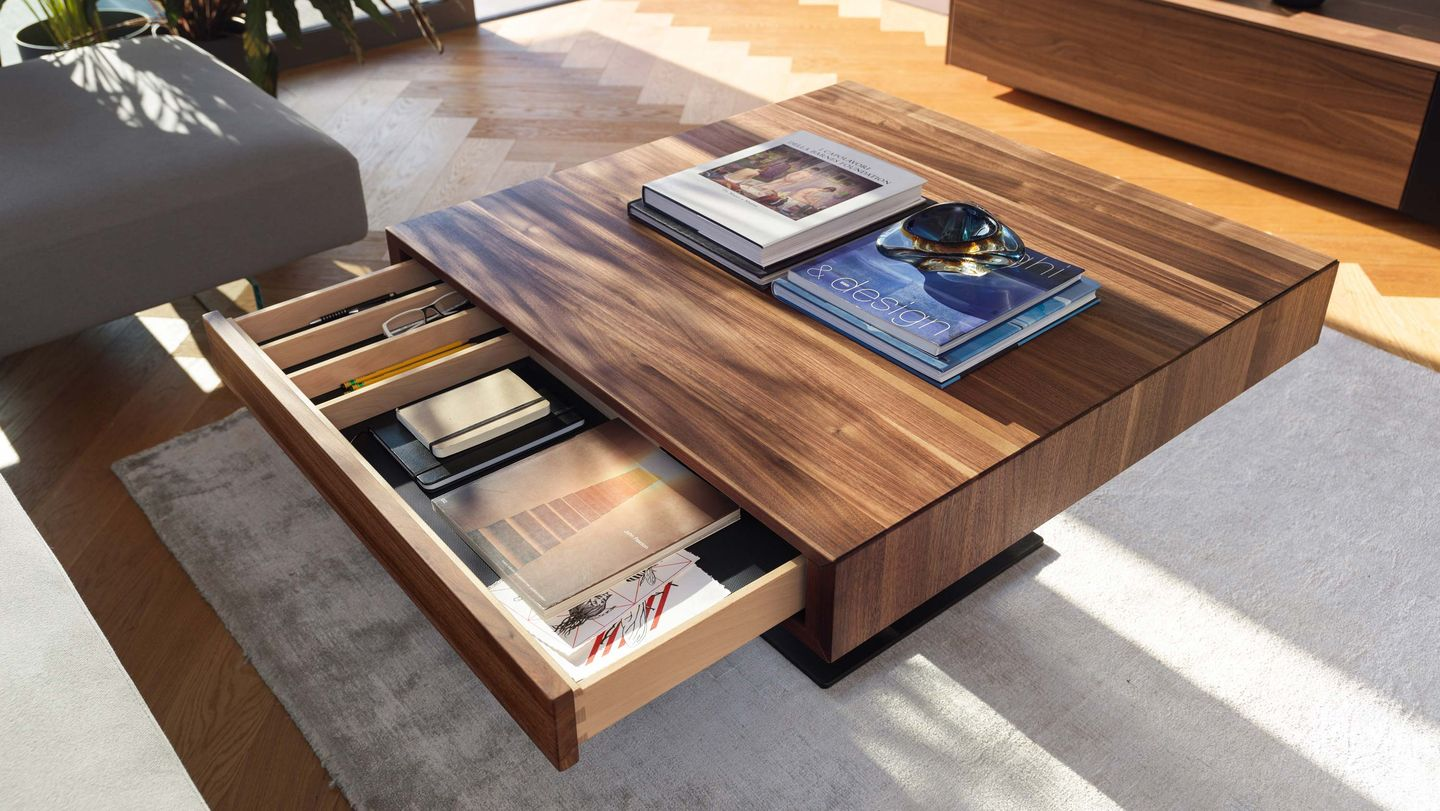 lift coffee table with open drawer in walnut