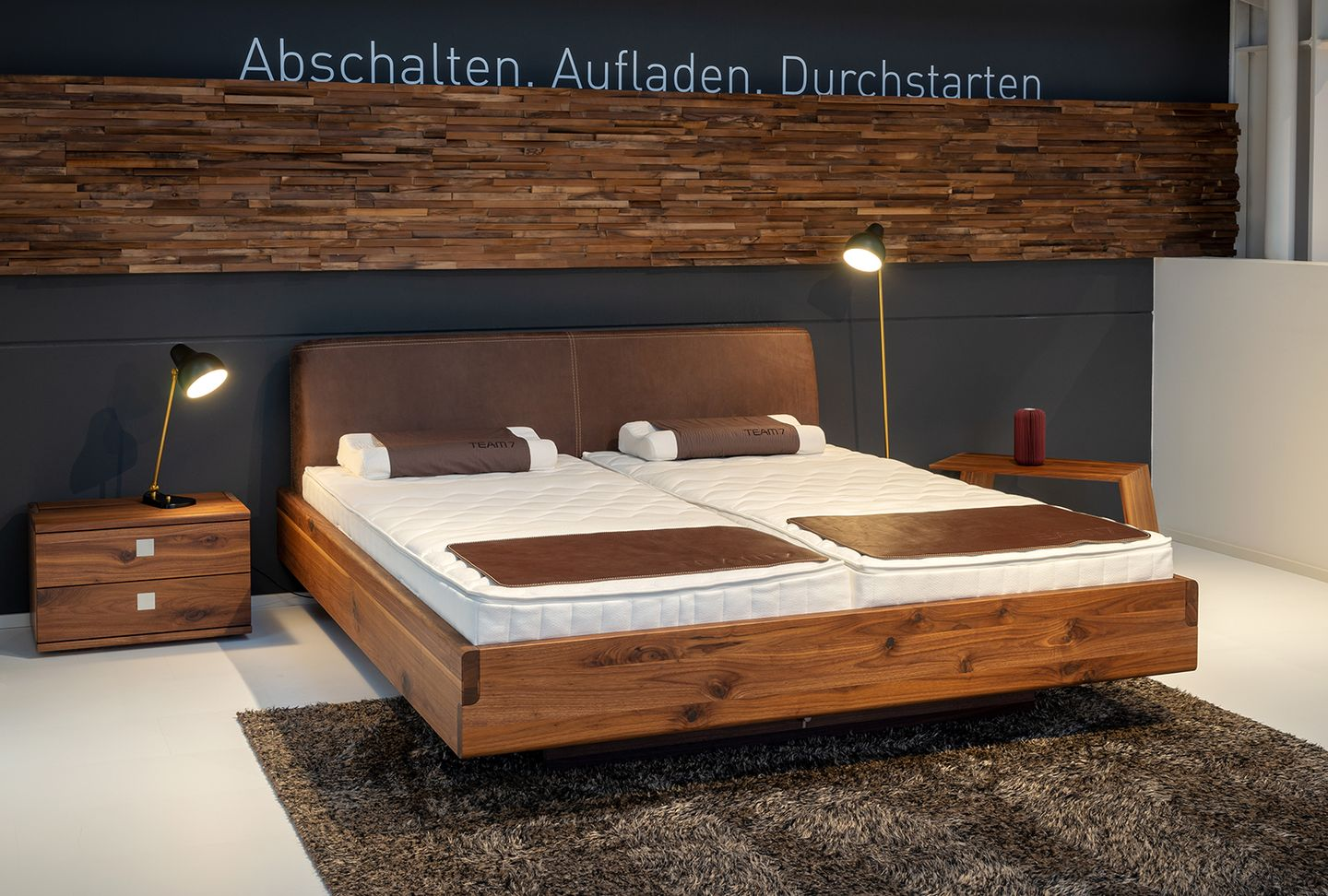 nox bed in oak with bedside cabinet at TEAM 7 Hamburg Altona