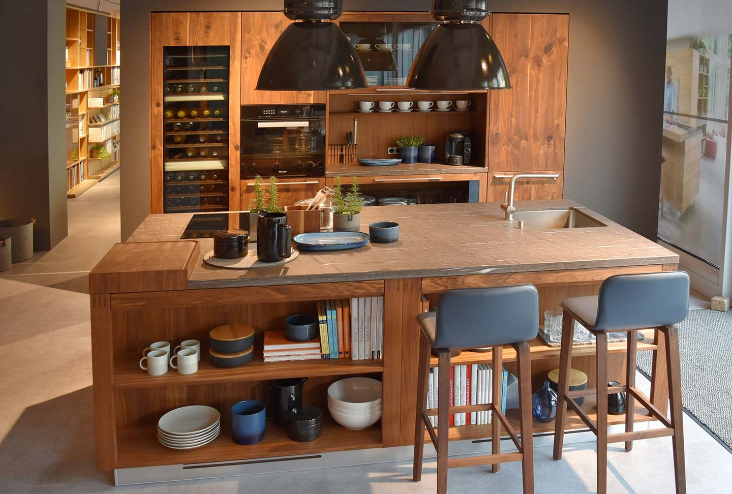 loft solid wood kitchen in walnut at TEAM 7 store Stuttgart