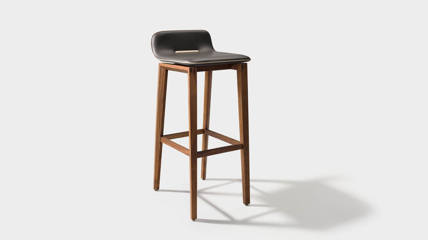 ark bar stool in leather with wooden legs in walnut