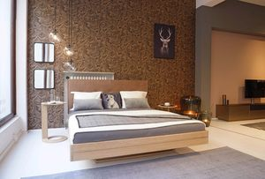 float solid wood bed in oak at TEAM 7 store Munich