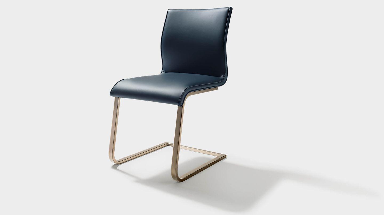 Chaise cantilever magnum avec piétement en bronze mat