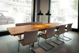 nox extendable table with bench made of leather at TEAM 7 Hamburg City