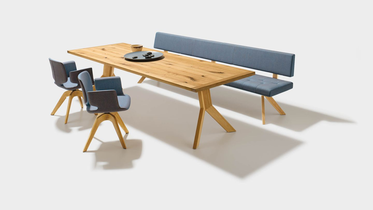 yps dining table in solid wood with aye chairs and yps bench in fabric