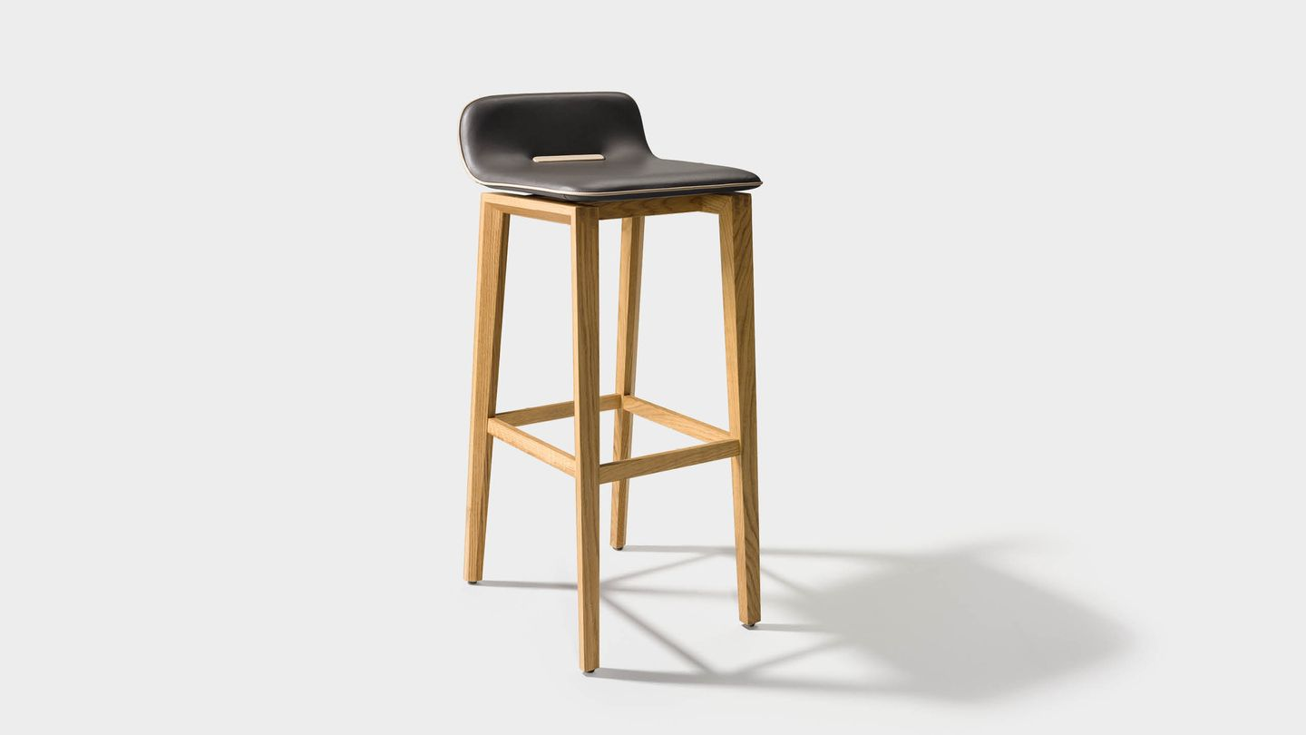 ark bar stool in leather with wooden legs in oak