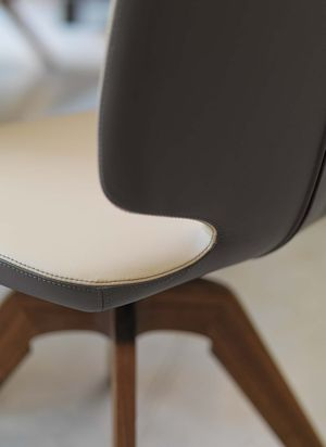 aye designer chair in two colours of leather with swivel base