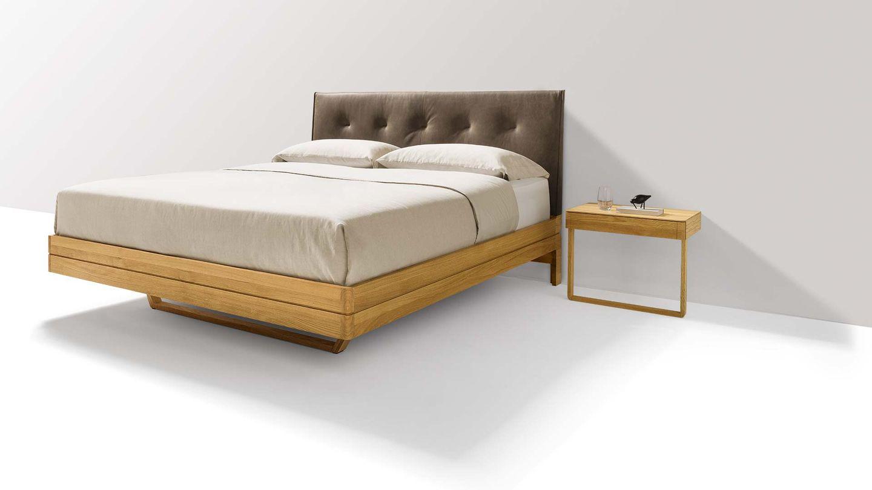 Lit design en bois avec tête de lit en cuir