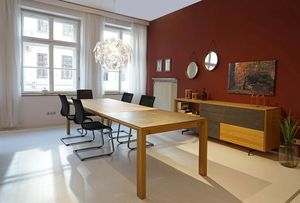 magnum extendable table with cantilever chairs Stricktex at TEAM 7 Munich