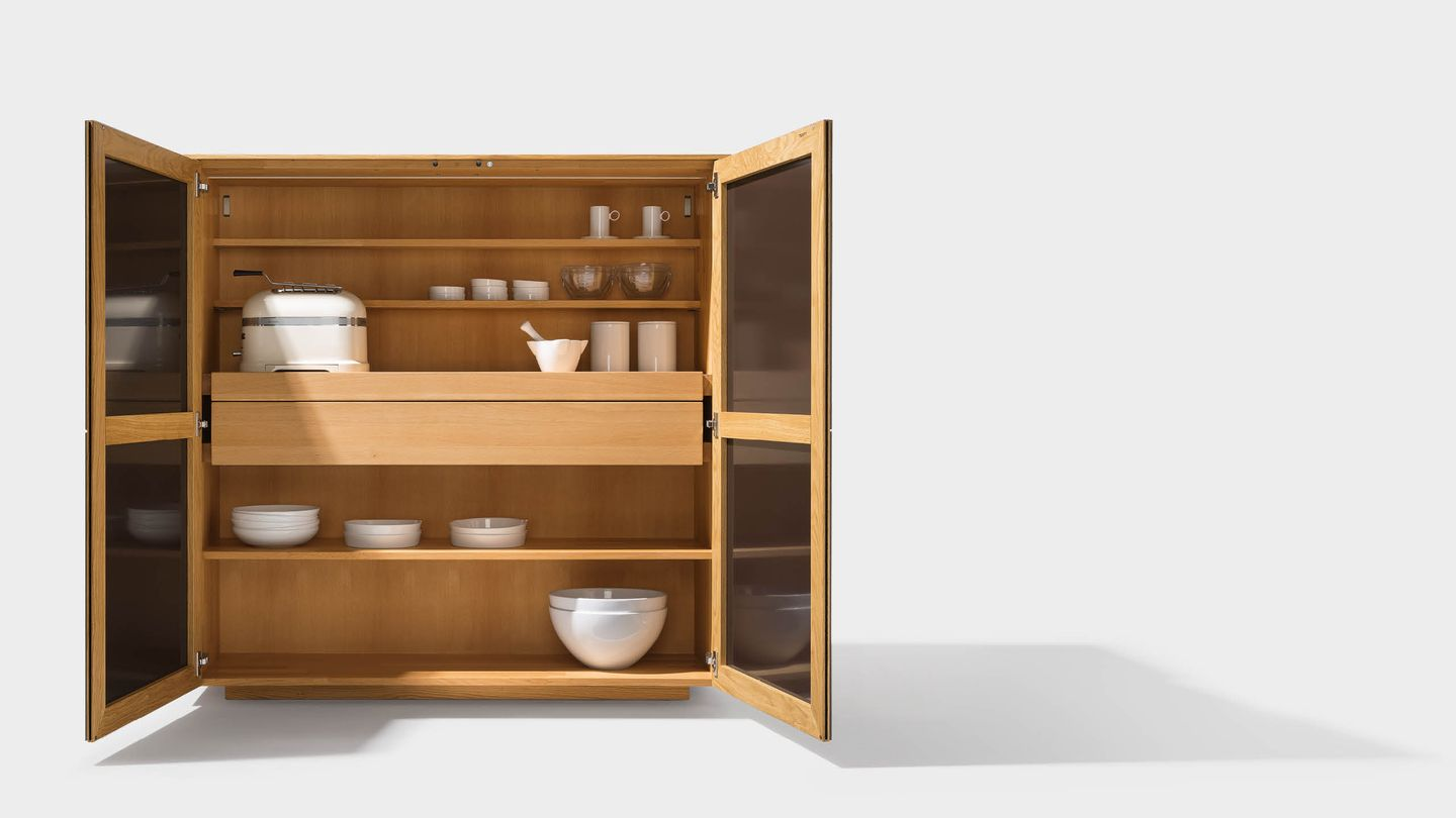 filigno highboard interior with doors and ceramic surface