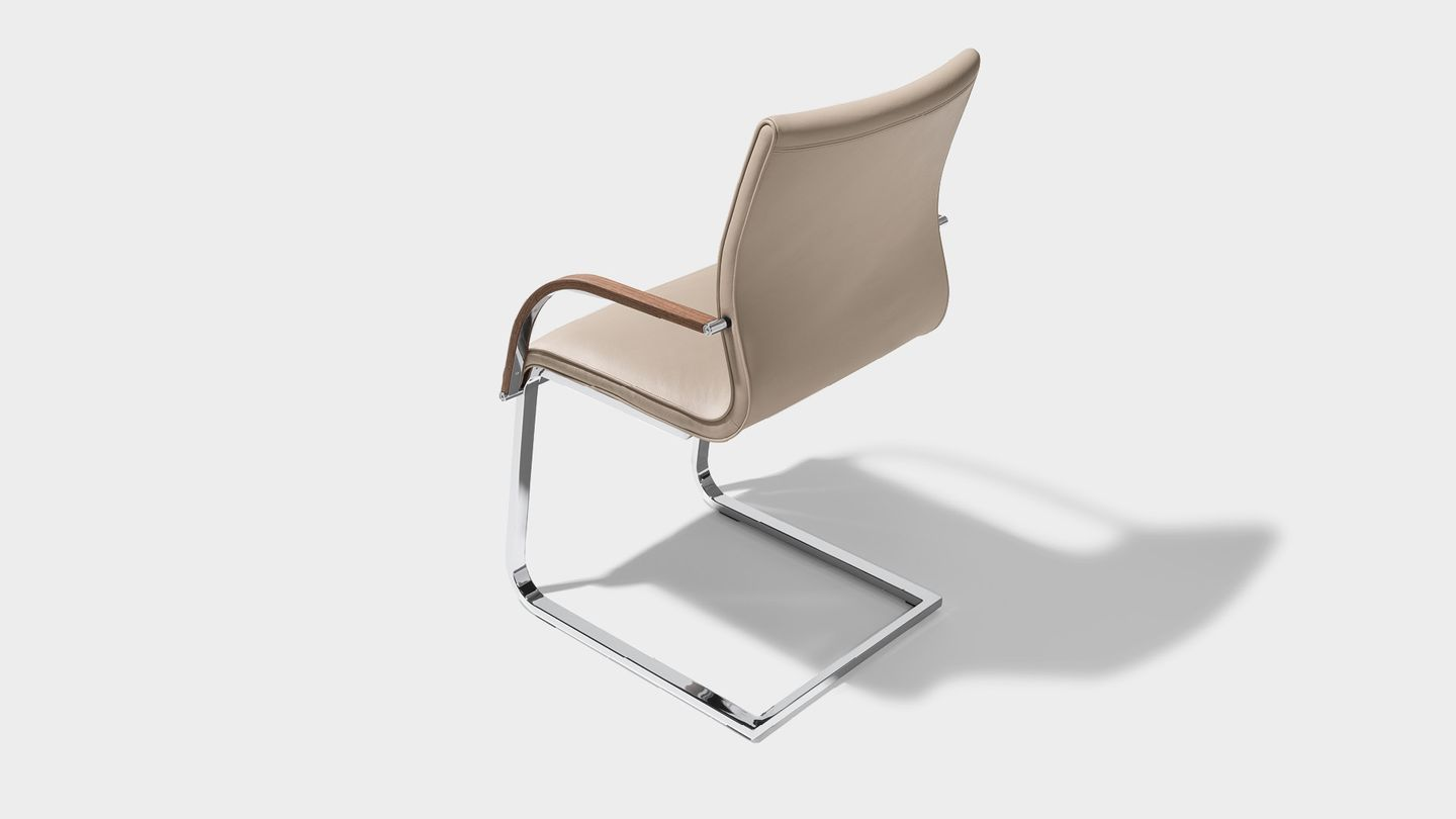 magnum chair leather with armrests by TEAM 7