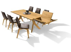 yps extendable table made of wood with lui chairs
