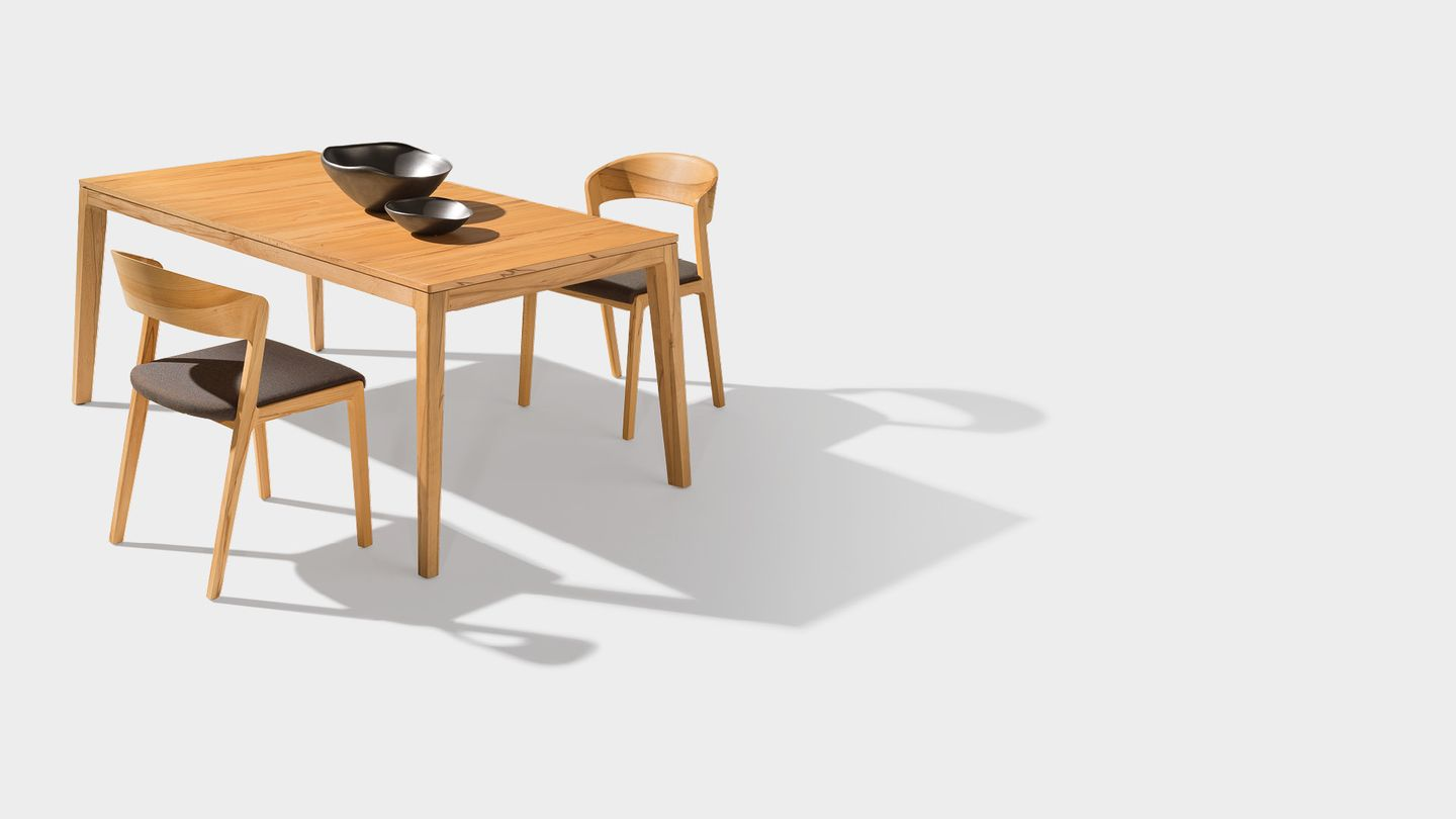 mylon table with upholstered mylon chair in beech heartwood