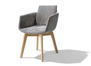 grand lui upholstered chair with armrests and striking folds by TEAM 7