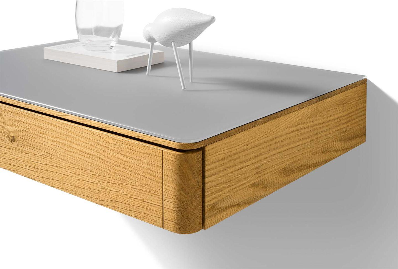 Table de chevet float en bois suspendue avec surface en verre en détail