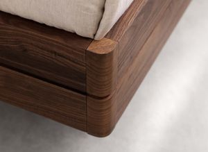 float wood bed with rounded corners in walnut